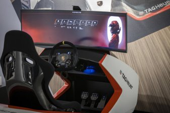 Please take a seat in the Formula E racing simulator.