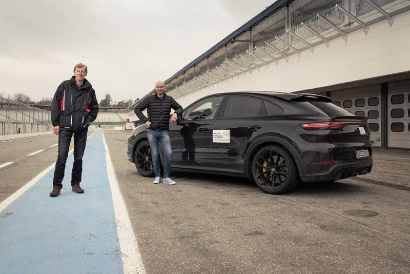 Brand ambassador Walter Röhrl and test driver Lars Kern with the still slightly camouflaged prototype of a new Cayenne model in Hockenheim.