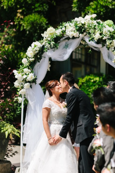 First kiss of the bride and groom (Stanley Park Pavilion)