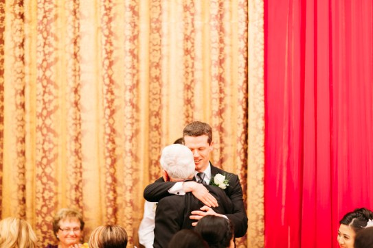 Groom hugging the father