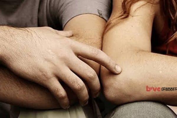 boy touching girls arm