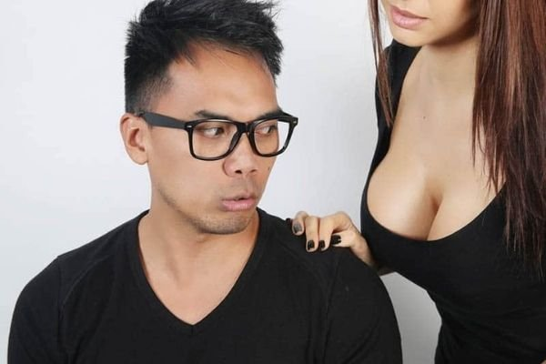 man looking at woman boobs