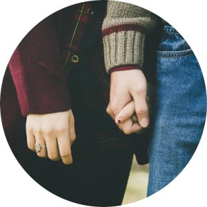 Close up of a couple holding hands for Love Heal Grow Counseling. Contact a Sacramento therapist to learn more about online couples therapy and marriage counseling in California. Online couples sex therapy in Sacramento, CA can support you!