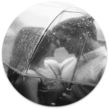 A couple stand together under the same umbrella as the rain pours. This could represent a couple overcoming hardship. Learn about online affair recovery in California, or how online couples therapy and marriage counseling can support you!