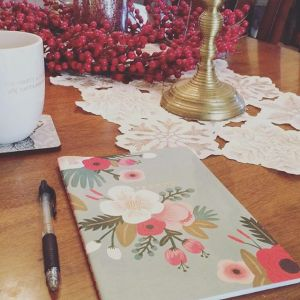 A notebook resting on a table next to a pen and lamp for Love Heal Grow. A Sacramento therapist can help you with anxiety treatment and other services. Online therapy in California can provide the support you deserve.