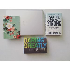 Brene Brown novels lay next to a laptop and notebook. Contact an anxiety therapist in Sacramento, CA for support through anxiety treatment, online anxiety therapy, and other services.