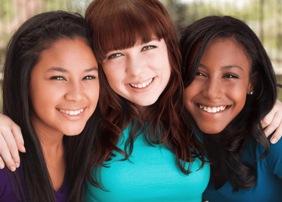 Three teen girls smile at the camera as they put their arms around one another. This could symbolize how open some may feel after talking through their stressors with a therapist for teens in Sacramento, CA. Contact a teenage therapist to learn if in person therapy for teens could support you! We also offer online therapy for teens in California as well!