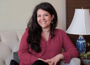 Megan n sits and smiles at the camera. She is a sacramento therapist that offers online couples therapy and marriage counseling in california and other services. Contact an online therapist to learn more about online therapy in California.