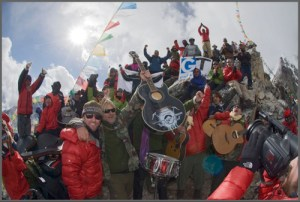 Love Hope Strength founders James Chippendale and Mike Peters celebrate with the rest of the Everest Rocks team after the highest rock concert in the world at 18,536 feet atop Kala Pattar at the foot of Mount Everest, Nepal.