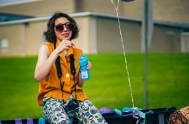 Isabella Huelsman blows bubbles in a vintage get-up