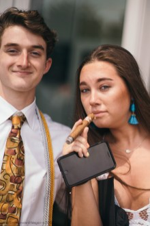 Ian Feilds and Abby Savage pose with a cigar