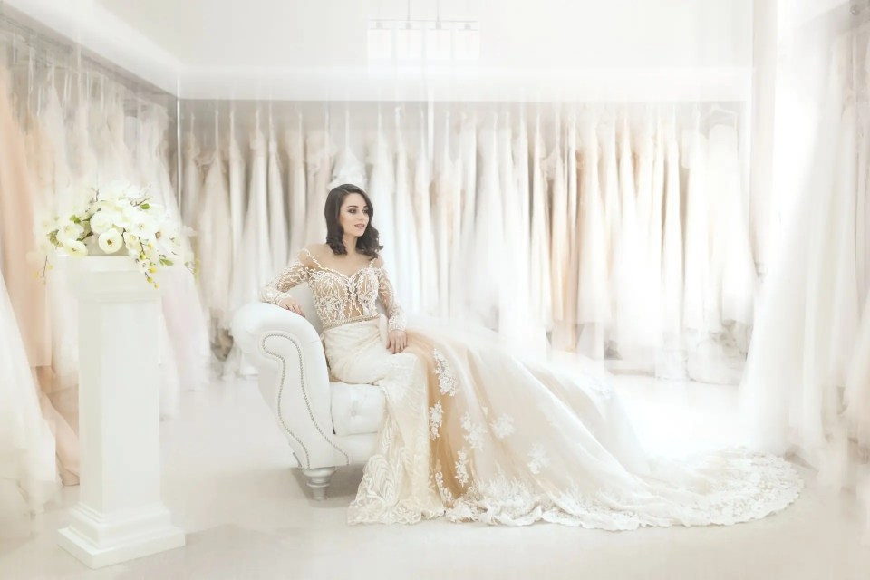 wedding dresses cost - bride in bridal boutique