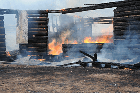 Fiendish flames with a green tint consume the inside of the Ewing-Snell Ranch house during the wind-whipped blaze last Wednesday afternoon.  David Peck photo