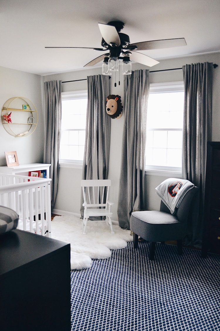 Go all black with a pop of red with a red rug and one wall decorated in the same color. Toddler Big Boy Room Reveal - Lovely Lucky Life