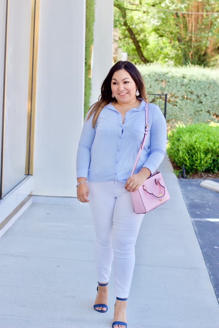 white jeans, blue pajama top, pink purse