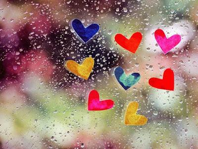 rainy window with heart stickers