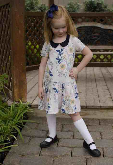 Prisma with pleated skirt and Peter Pan collar