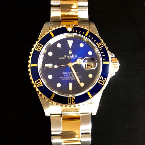 The couple's recent acquisition. Rolex 16613 two-tone Submariner
