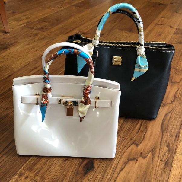 White handbag - Black Sheep Biki 30 - $160 USD - blksheepofficial.com Black handbag - Dooney & Bourke Top Zip Satchel - dooney.com