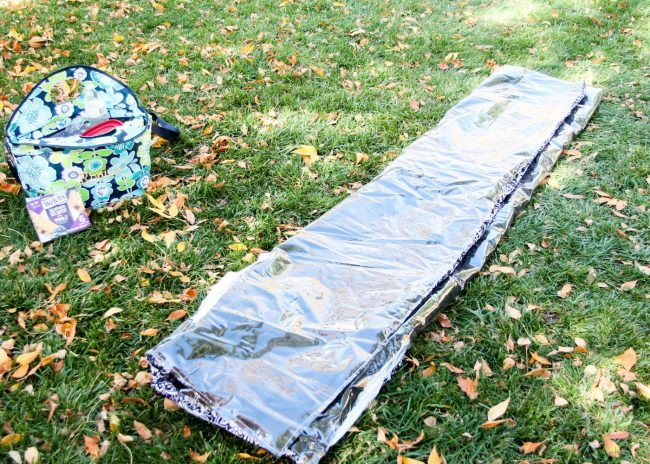 Folding your DIY picnic blanket step 2