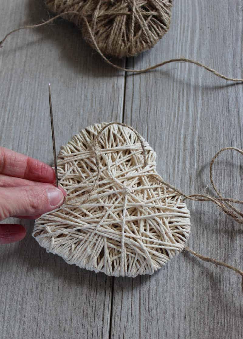 Thread string through hearts for Valentine's Day String Heart banner