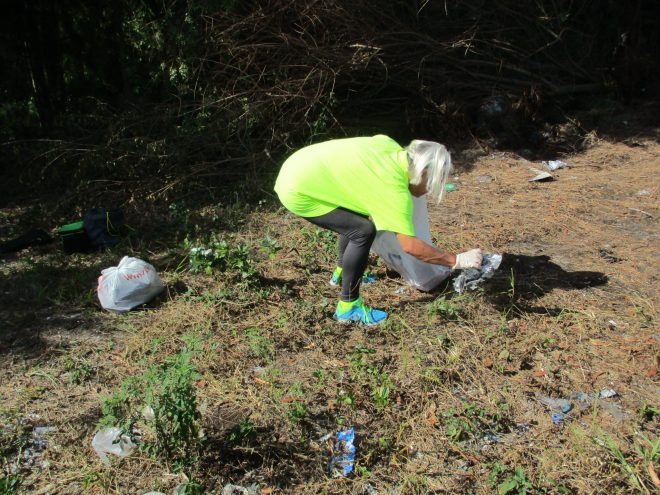 picking litter from a natural area