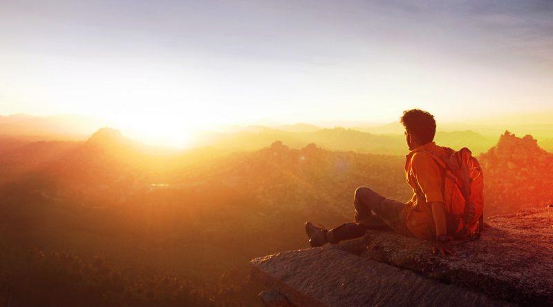 man-sitting-on-edge-facing-sunset-(lovestatuswhatsapp.com)