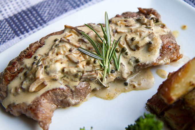 Steak in mushroom, peppercorn, and brandy sauce