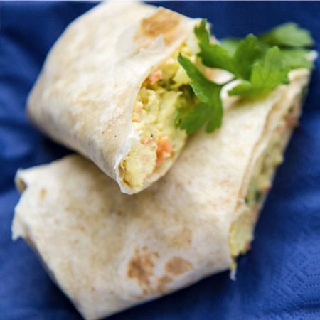Scrambled egg and smoked salmon tortilla wrap