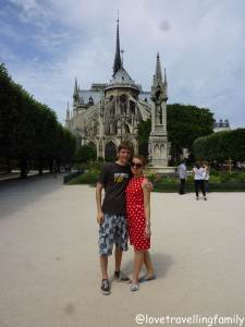 Love travelling family at Notre Dame Cathedral, Paris France