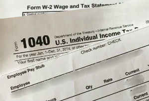 Stack of financial document forms for submital during the IR-1/CR-1 Spousal Visa NVC Phase