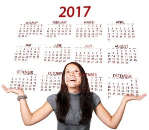 Woman looking at the calendar of 2017 to schedule interview