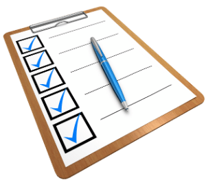 Clip board and paper with check marks on forms needed for K-1 Fiance(e) Visa USCIS Phase and IR-1/CR-1 Spousal Visa USCIS Phase.