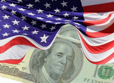 An american flag over top of a $100 bill.
