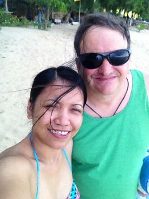 A couple on the beach at Joven's Blue Sea Resort on Cagbalete Island