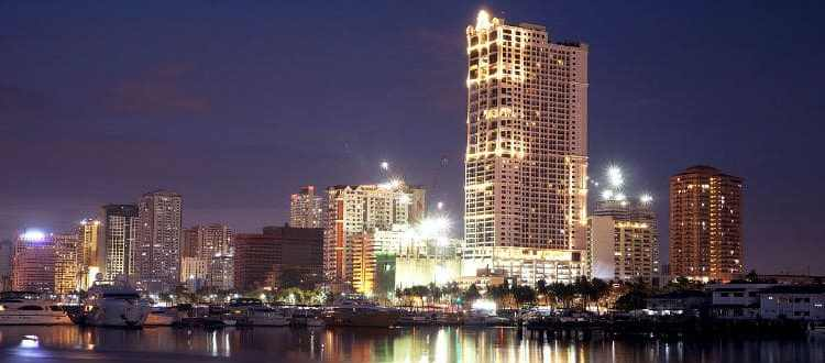 Manila skyline at night. Find places to make your Philippine hotel reservations using TravelBook.ph