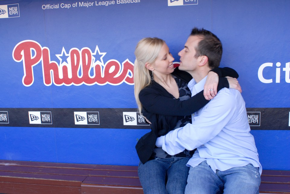 Couple Shares a Moment in Dugout