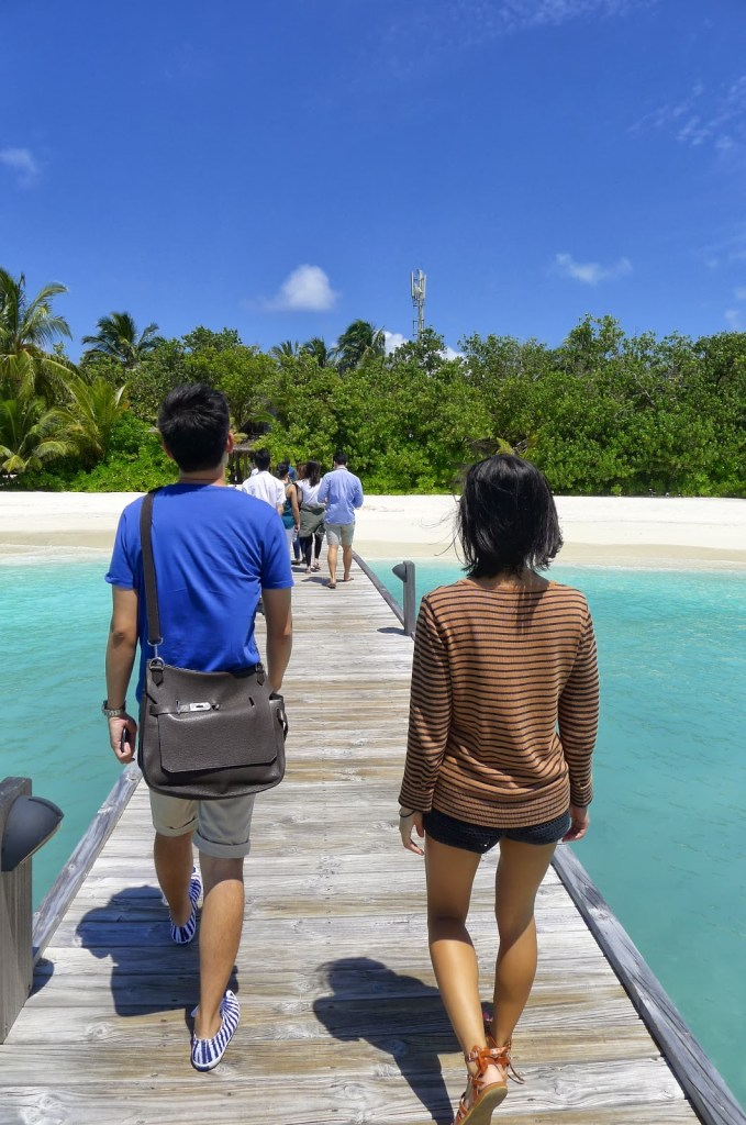 Walking behind WT and JL after alighting from the boat.
