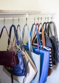 Organize your purses with shower hooks