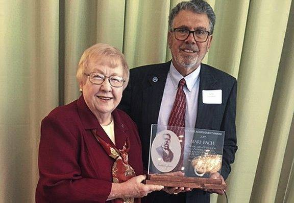Mary Bach of Murrysville is presented with the Westinghouse SURE 2019 Lifetime Achievement Award by President Lucio Facchini.