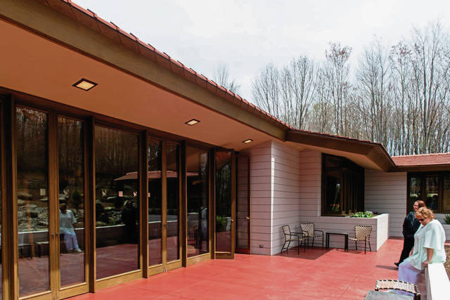 The patio stretches the length of the living room and kitchen, looking out over a water feature towards the surrounding trees, at Frank Lloyd Wright's Mantyla at Polymath Park in Mt. Pleasant Township, on Monday, April 29, 2019.