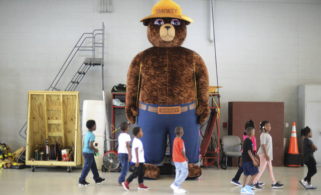 A giant Smokey Bear statue greets children at and open house at Fire Station One in Kinston, N.C. The icon of the longest-running public service campaign in the U.S., was born on Aug. 9, 1944, when the U.S. Forest Service and the Ad Council agreed that a fictional bear would be the symbol for a fire prevention campaign.