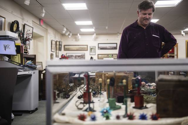 Don Lachie talks about his collection of Christmas lights, some dating back into the early 1800s, as he prepares his display in the Pennsylvania Room of the Ligonier Valley Library. Lachie will be talking about his collection during an event on Dec. 3.