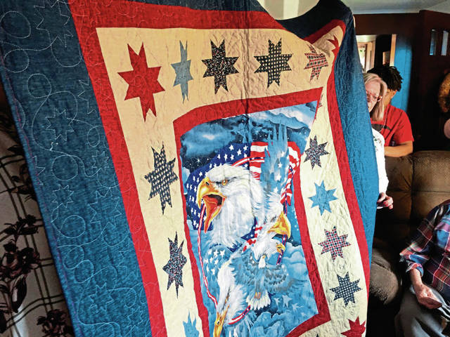 """My quilts tend to grow,"" Antis said. Her father's quilt, which she describes as a ""labor of love,"" is 5 feet-by-6<sup>1</sup>⁄<sub>2 </sub>feet. She was careful to ensure the work would be kept secret."