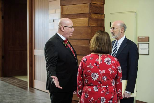 Franklin Regional Superintendent Gennaro Piraino Jr. (left), and Gov. Tom Wolf, greet each other before Piraino is presented with the 2019 Pennsylvania Superintendent of the Year award, during a ceremony at the Fred Rogers Center in Saint Vincent College, on Thursday, on Jan. 17, 2019.