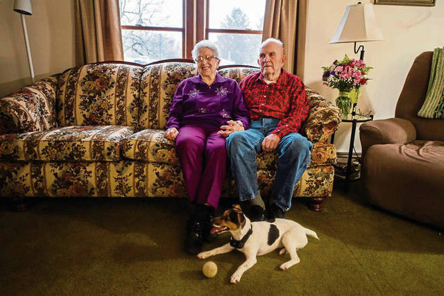 Clarence, 92 and Wilma Pechart, 91, hold hands while sitting on the couch at their 75th wedding anniversary Saturday<ins>,</ins><ins> Jan. 18, 2020</ins> at their home in Ligonier Township while with their son's dog, Tidbit.