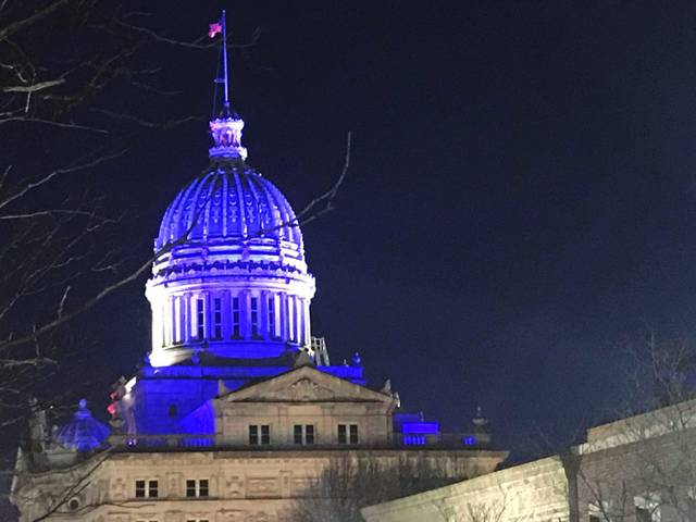 The Westmoreland County Courthouse dome is illuminated in blue to honor those battling the coronavirus pandemic.