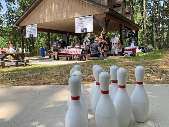 Supporters of Big Brothers Big Sisters of the Laurel Region attend a picnic Sunday at Twin Lakes Park. The organization had to offer a safe alternative to its biggest fundraiser of the year, a bowlathon.