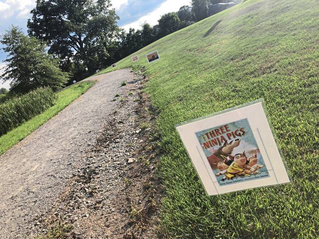 "The Murrysville library and municipal recreation department collaborated on a ""Storywalk"" trail at the Murrysville Community Park wetlands. Families can read ""The Three Ninja Pigs"" as they walk the trail."