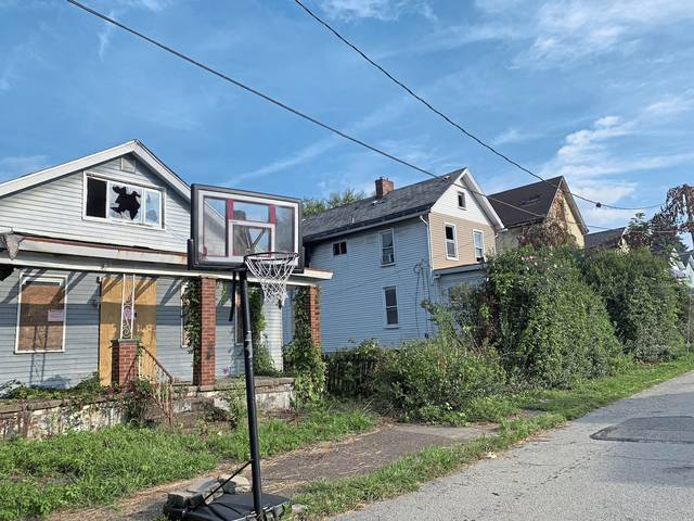 Some brush and weeds have been cleared from abandoned properties on 12th Street in West Jeannette as pictured on Tuesday. A Murrysville church group did the work last month.